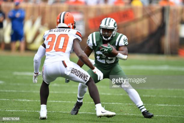 Bilal Powell of the New York Jets attempts to move past Jason McCourty of the Cleveland Browns at FirstEnergy Stadium on October 8 2017 in Cleveland...