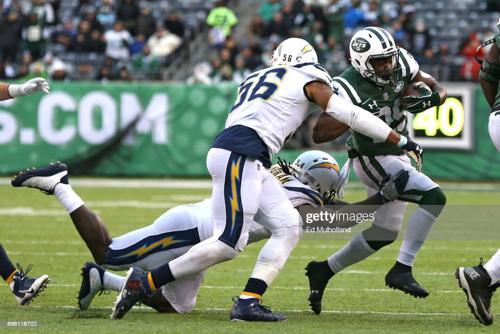 Bilal Powell #29 of the New York Jets attempts to run past Korey Toomer #56 of the Los Angeles Chargers during the second half of an NFL game at MetLife Stadium on December 24, 2017 in East Rutherford, New Jersey. The Los Angeles Chargers defeated the New York Jets 14-7.