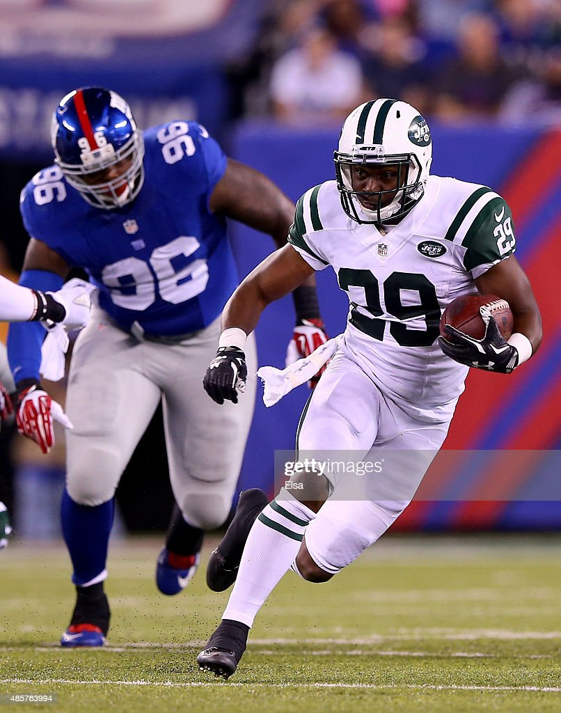 Bilal Powell #29 of the New York Jets carries the ball as Jay Bromley #96 of the New York Giants defends in the first half during preseason action at MetLife Stadium on August 29, 2015 in East Rutherford, New Jersey.