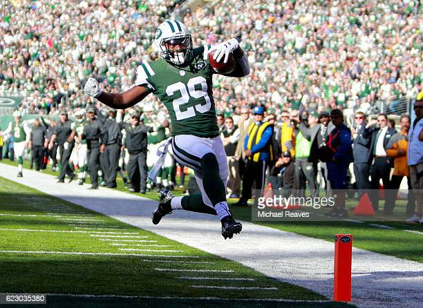 Bilal Powell of the New York Jets leaps into the endzone for a touchdown against the Los Angeles Rams in the second quarter at MetLife Stadium on...