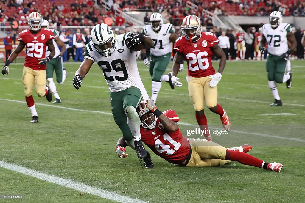 Bilal Powell #29 of the New York Jets rushes for a 19-yard touchdown to beat the San Francisco 49ers in overtime in their NFL game at Levi's Stadium on December 11, 2016 in Santa Clara, California.
