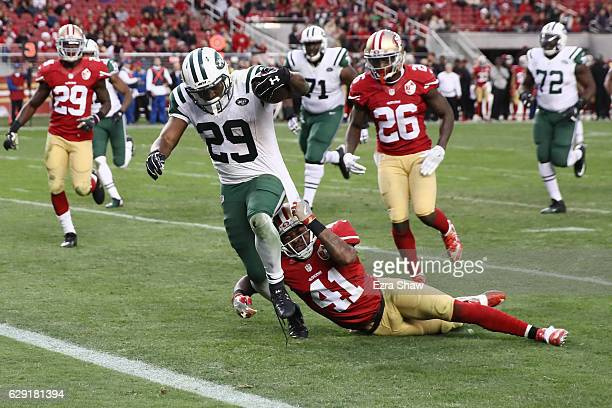Bilal Powell of the New York Jets rushes for a 19yard touchdown to beat the San Francisco 49ers in overtime in their NFL game at Levi's Stadium on...