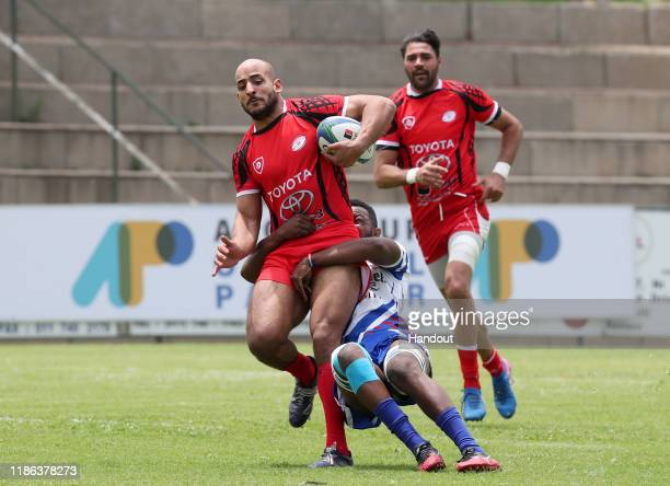 Bilal Soken of Tunisia challenged by Muharua Katjyeko of Namibia during the 2019 Rugby Africa Mens 7s match between Tunisia and Namibia at the Bosman...