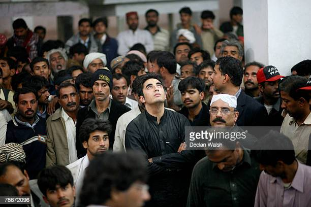 Bilawal Bhutto , 19-year-old son of Benazir Bhutto, and Asif Zardari, Bhutto's husband stand over the grave of Pakistani opposition leader Benazir...