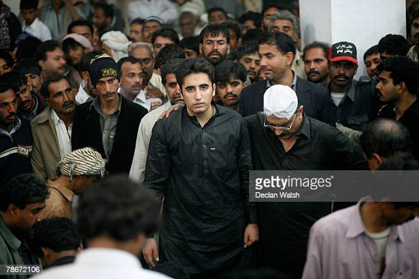 Bilawal Bhutto , 19-year-old son of Benazir Bhutto, and Asif Zardari, Bhutto's deceased husband stand over the grave of Pakistani opposition leader...
