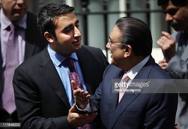 Bilawal Bhutto tries to persuade his father President Zardari of Pakistan to talk to reporters in Downing Street on July 1 2011 in London England Mr...
