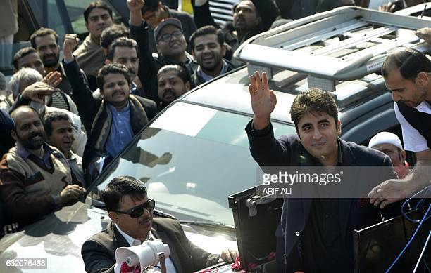 Bilawal Bhutto Zardari chairman of Pakistan Peoples Party waves as he leads a rally against corruption to Faisalabad from Lahore on January 19 2017 /...