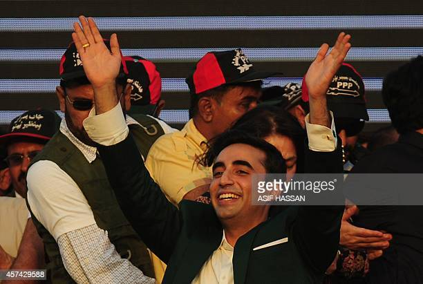 Bilawal Bhutto Zardari chairman of Pakistan Peoples Party waves to supporters during his arrival for a public gathering in Karachi on October 18 2014...