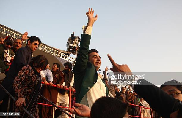 Bilawal Bhutto Zardari head of main opposition Pakistan People's Party waves to supporters at a public gathering in Karachi on October 18 2014 Tens...