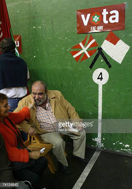 Action Nationalist Basque party President and General Secretary Kepa Bereziartua is greeted by an unidentified woman during local election...