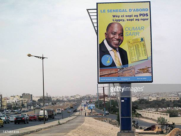 A bilboard shows a campaign advertisement for Oumar Sarr of the Democratic Party of Senegal in the upcoming legislative elections on June 29 2012 in...