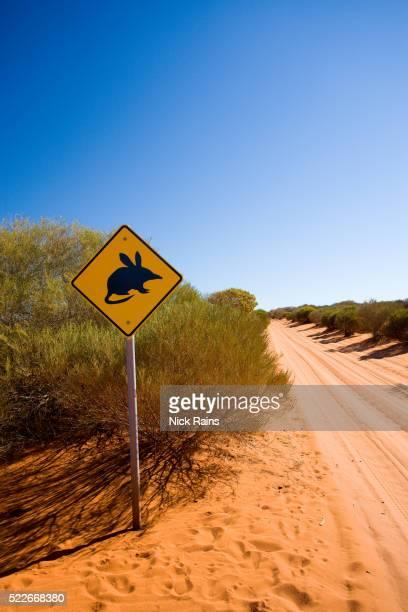 Bilby crossing sign along dirt road in Western Australia
