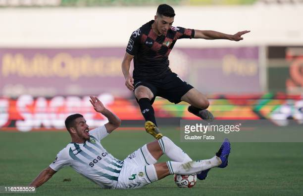 Bilel Aouacheria of Moreirense FC with Artur Jorge of Vitoria FC in action during the Liga NOS match between Vitoria FC and Moreirense FC at Estadio...