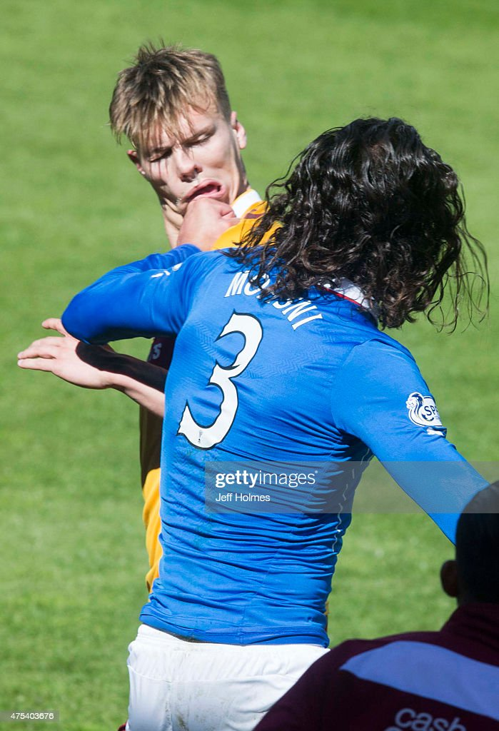 Bilel Mohsni of Rangers clashes with Lee Erwin of Motherwell during the Scottish Premiership play-off final 2nd leg between Motherwell and Rangers at Fir Park on May 31, 2015 in Motherwell, Scotland.