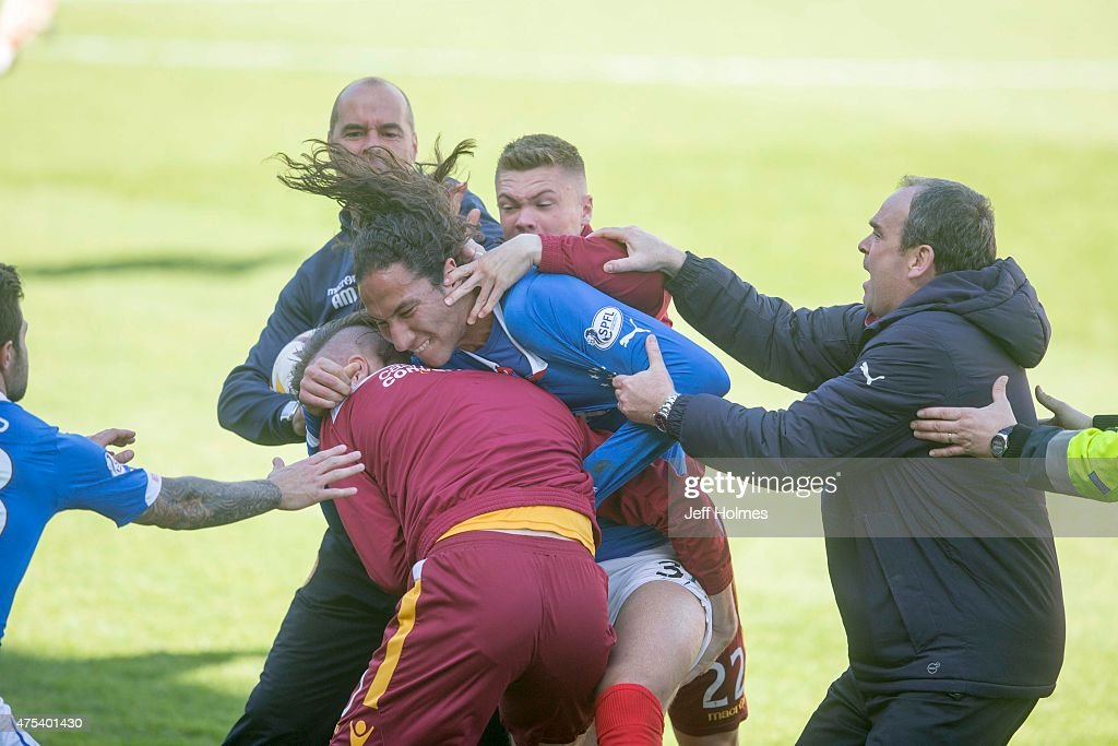 Bilel Mohsni of Rangers clashes with Motherwell players during the Scottish Premiership play-off final 2nd leg between Motherwell and Rangers at Fir Park on May 31, 2015 in Motherwell, Scotland.