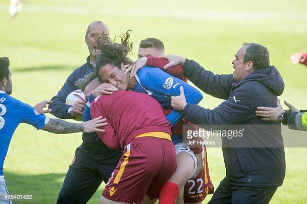 Bilel Mohsni of Rangers clashes with Motherwell players during the Scottish Premiership playoff final 2nd leg between Motherwell and Rangers at Fir...