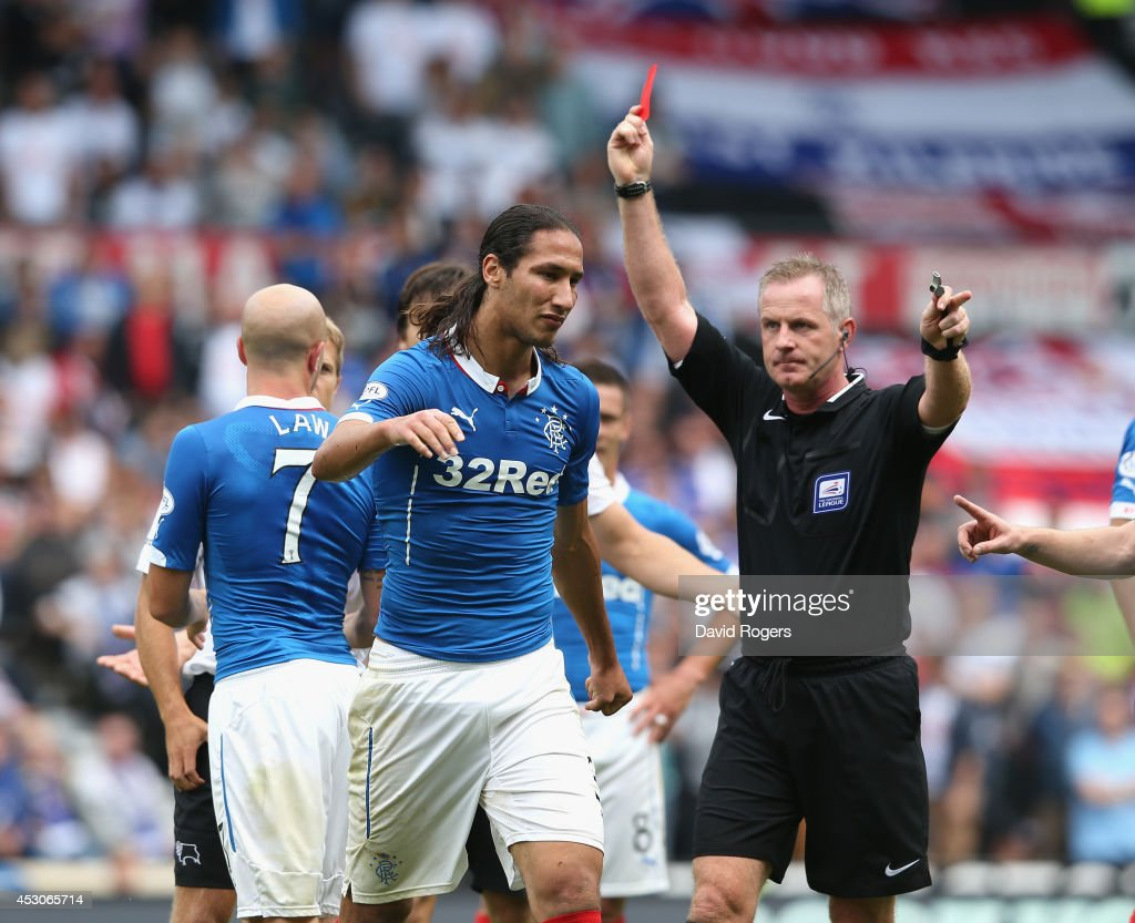 Bilel Mohsni of Rangers is sent off by referee Mark Heywood during the pre season friendly match between Derby County and Rangers at iPro Stadium on August 2, 2014 in Derby, England.