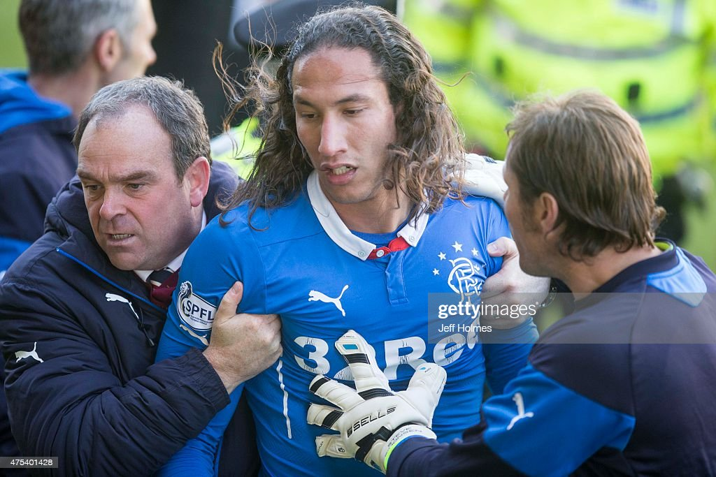 Bilel Mohsni of Rangers is taken off the pitch after a scuffle during the Scottish Premiership play-off final 2nd leg between Motherwell and Rangers at Fir Park on May 31, 2015 in Motherwell, Scotland.