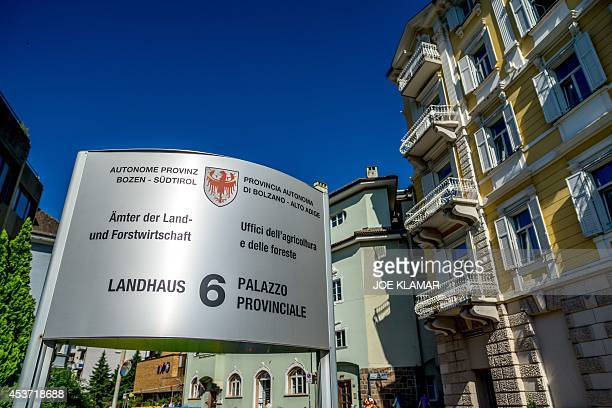 A bilingual sign in front of Provincial Administration building of Autonome Province of South Tirol is seen on June 26 2014 the city of Bolzano...