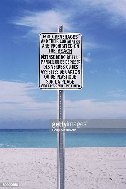 Bilingual Sign on a Beach