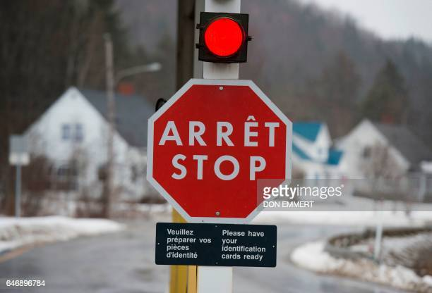 A bilingual stop sign is seen at the US/Canada border March 1 in East Hereford Quebec The Canadian entry point at the crossing is East Hereford...