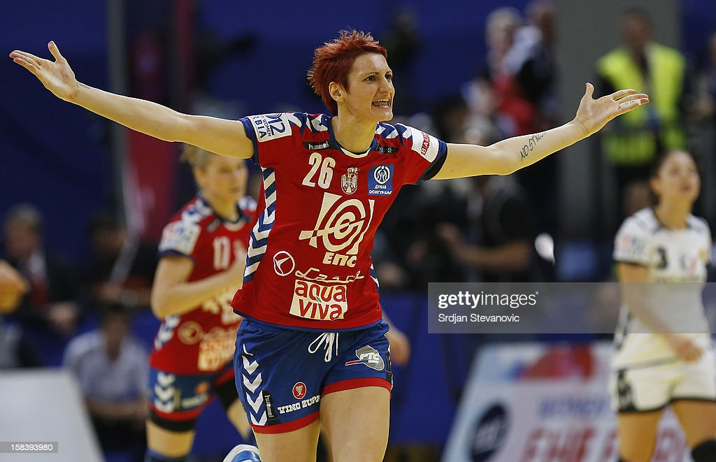 Biljana Filipovic (C) of Serbia celebrates after scoring a goal during the Women's European Handball Championship 2012 semifinal match between Serbia and Montenegro at Arena Hall on December 15, 2012 in Belgrade, Serbia.