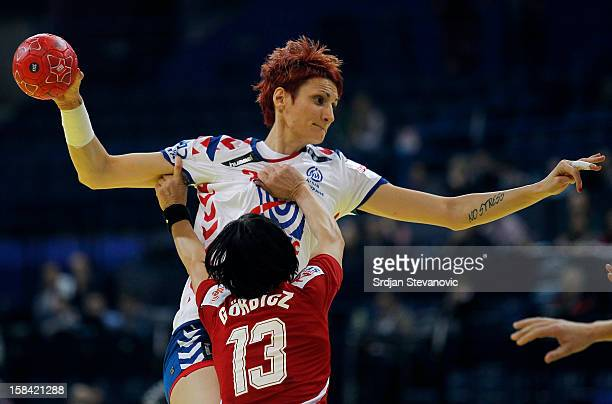 Biljana Filipovic of Serbia is challenged by Anita Gorbicz of Hungary during the Women's European Handball Championship 2012 third place match...