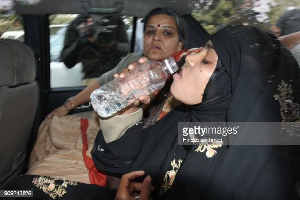 Bilkis Bano a gangrape survivor from the 2002 Gujarat riots drinking water after adressing media at Press Club of India in New Delhi