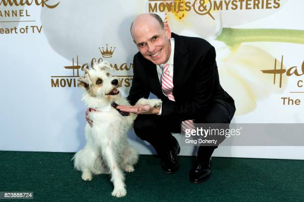 Bill Abbott President and Chief Executive Officer and Happy the Dog arrive at the 2017 Summer TCA Tour Hallmark Channel And Hallmark Movies And...