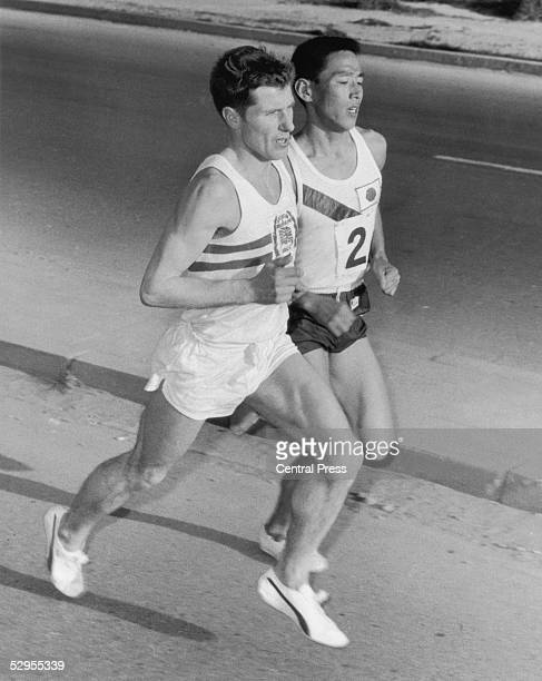 Bill Adcocks of Great Britain overtakes a Japanese competitor on the way to victory in the Athens marathon, 8th April 1969. He finished in a time of...