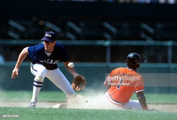 Bill Almon of the Chicago White Sox takes the throw as Al Bumbry of the Baltimore Orioles steals second base during an Major League Baseball game...