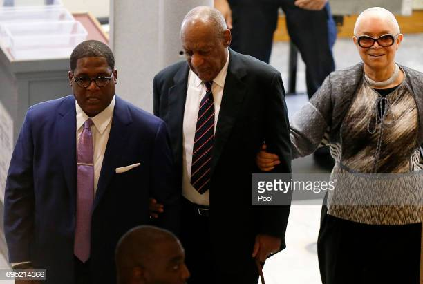 Bill and Camille Cosby and aide Andrew Wyatt enter the Montgomery County Courthouse on June 12 2017 in in Norristown Pennsylvania A former Temple...