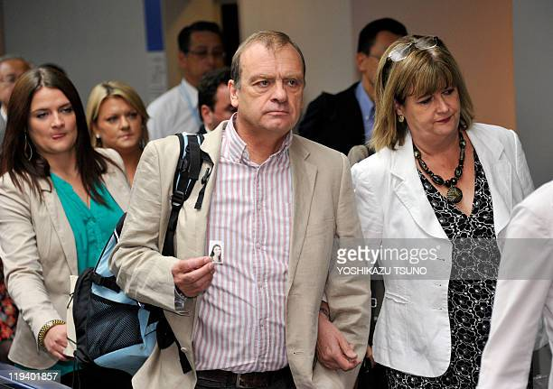 Bill and Julia Hawker father and mother of slain 22yearold British female teacher Lindsay Ann Hawker arrive at Narita international airport to...