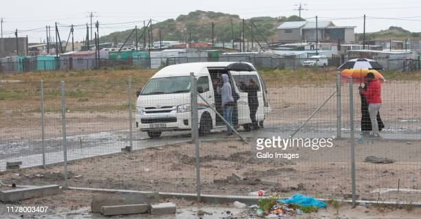 Bill and Melinda Gates arrives via a minibus taxi in the township of Khayelitsha on October 25 2019 in Cape Town South Africa The worlds richest man...