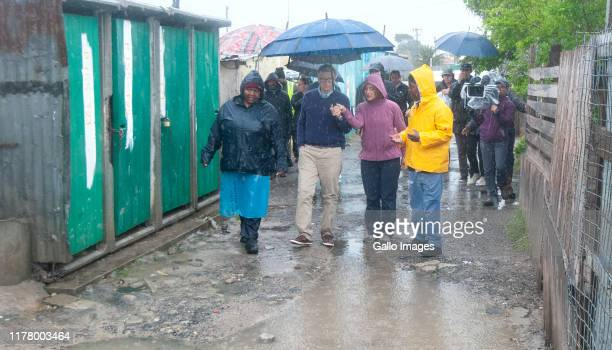 Bill and Melinda Gates brace the rain as they visit the township of Khayelitsha on October 25 2019 in Cape Town South Africa The worlds richest man...