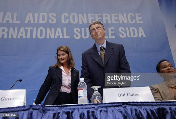 Bill and Melinda Gates Cochairs of the Bill and Melinda Gates Foundation take their seats alongside Conference Cochair Helene Gayle at the opening...