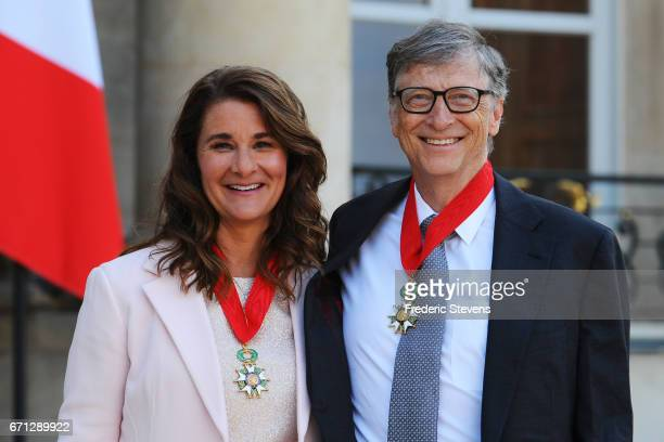Bill and Melinda Gates pose in front of the Elysee Palace after receiving the award of Commander of the Legion of Honor by French President Francois...