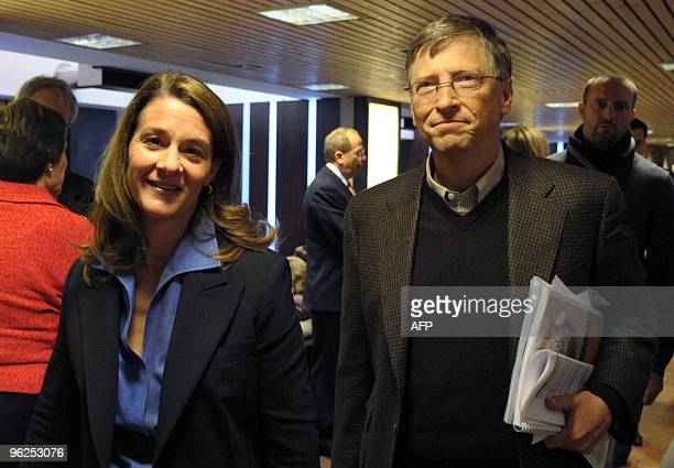 Bill and Melinda Gates walk in the Congress center at the World Economic Forum on January 29 2010 in Davos The World Economic Forum is attended by...