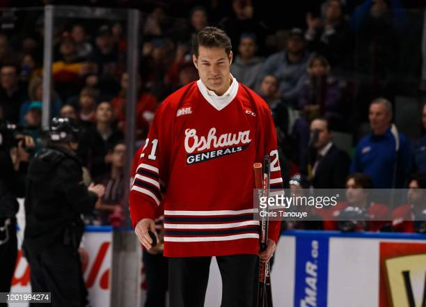 Bill Armstrong former player of the Oshawa Generals walks onto the ice during a pregame banner raising ceremony honouring the 1990 Memorial Cup...