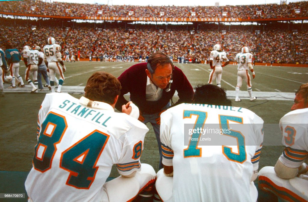 Bill Arnsparger, Defensive Coordinator of the Miami Dolphins, speaks with Bill Stanfill, Defensive End, and Manny Fernandez, Defensive Tackle, during an NFL Football game against the Baltimore Colts, December 16, 1972. : News Photo