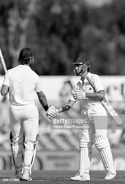 Bill Athey of England congratulates Chris Broad of England on reaching his century during his innings of 162 runs in the 2nd Ashes Test match between...