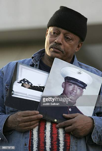 Bill Babbitt holds photos of his brother executed killer Manny Babbitt during a rally opposing the death penalty January 12 2005 on the steps of the...