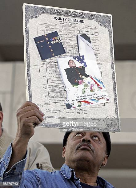 Bill Babbitt holds the death certificate of his brother executed killer Manny Babbitt during a rally opposing the death penalty January 12 2005 on...