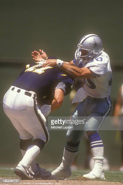Bill Bates of the Dallas Cowboys sacks Billy Joe Tolliver of the San Diego Chargers during a preseason football game on August 14 1989 at Jack Murphy...