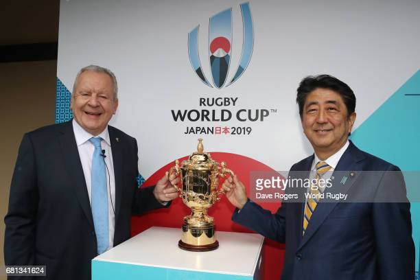 Bill Beaumont Chairman of World Rugby via Getty Images and Shinzo Abe Prime Minister of Japan pose with The William Webb Ellis Cup during the Rugby...