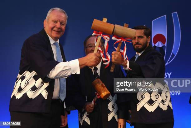 Bill Beaumont chairman of World Rugby poses with World Rugby vice chairman Agustin Pichot watched by Fujito Mitarai chairman of JR2019 during the...
