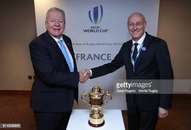 Bill Beaumont the World Rugby via Getty Images chairman congratulates FFR President Bernard Laporte after the annoucement that France will host Rugby...