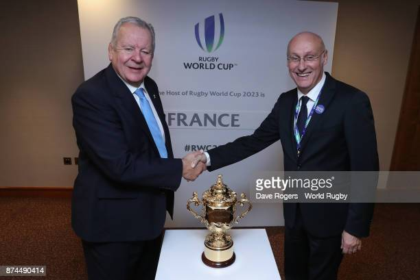 Bill Beaumont the World Rugby via Getty Images chairman shakes hands with FFR President Bernard Laporte after the annoucement that France will host...