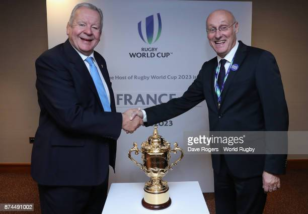 Bill Beaumont the World Rugby chairman shakes hands with FFR President Bernard Laporte after the annoucement that France will host Rugby World Cup...