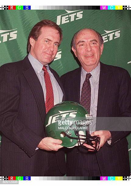 Bill Belichick former assistant coach of the New England Patriots and Steve Gutman president of the New York Jets pose for photographers at the Jets...